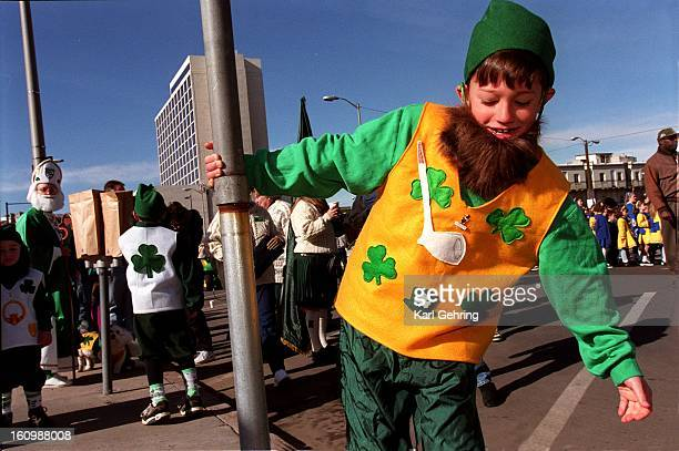 Beau Smith swung around a pole as he waited for the St patrick's Day parde to kick off Saturday morning He and his brother and two cousins marched...