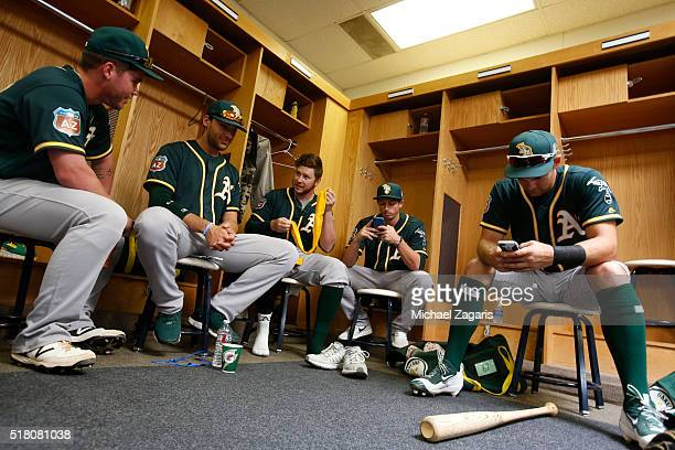 Beau Taylor Matt Olson Ryan Doolittle Ryan Dull amd Chad Pinder of the Oakland Athletics get ready in the clubhouse prior to a spring training game...