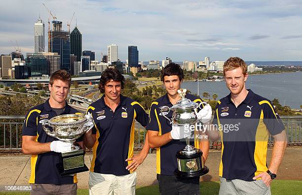 Beau Waters Andrew Embley Josh Kennedy and Ashley Hansen of the West Coast Eagles pose with the Australian Open Trophies during the Australian Open...
