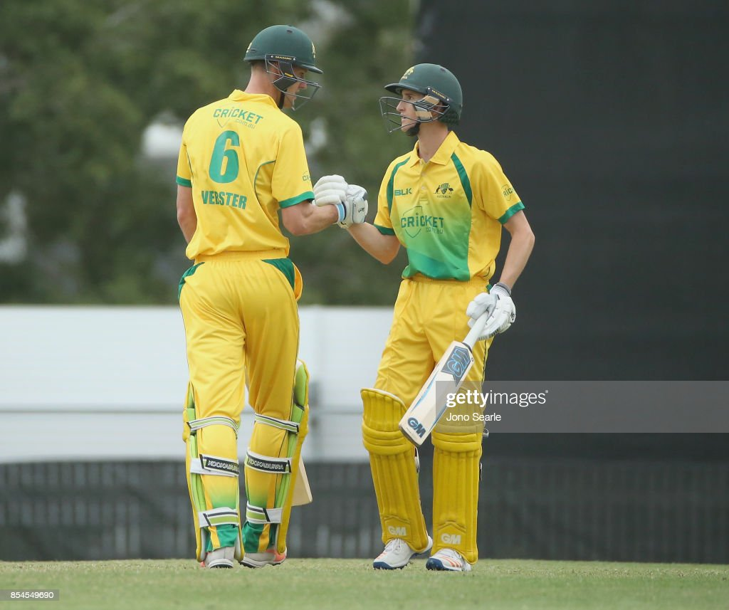 Beau Webster of CA XI celebrates his century with team mate Jake Carder during the JLT One Day Cup match between South Australia and the Cricket Australia XI at Allan Border Field on September 27, 2017 in Brisbane, Australia.