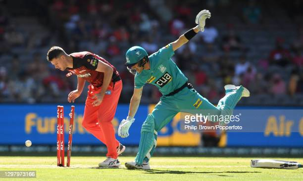 Beau Webster of Renegades loses control of the ball as Joe Denly of Heat reaches the crease without his bat during the Big Bash League match between...