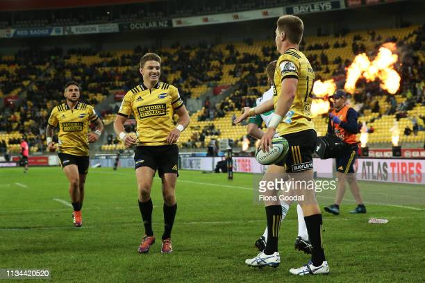 Beauden and Jordie Barrett celebrate a try during the round 4 Super Rugby match between the Wellington Hurricanes and Otago Highlanders at Westpac...