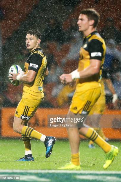 Beauden Barrett and brother Jordie Barrett of the Hurricanes look on during the round three Super Rugby match between the Chiefs and the Hurricanes...