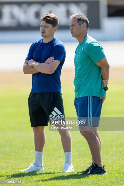 Beauden Barrett and Leon MacDonald, head coach during a Blues Super Rugby training session at Blues HQ on February 12, 2020 in Auckland, New Zealand.
