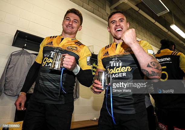 Beauden Barrett and TJ Perenara celebrate in the changing room after winning the 2016 Super Rugby Final match between the Hurricanes and the Lions at...