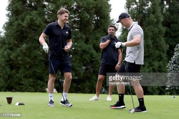 Beauden Barrett Anton LienertBrown and Sam Cane of the All Blacks play golf on September 29 2019 in Beppu Oita Japan