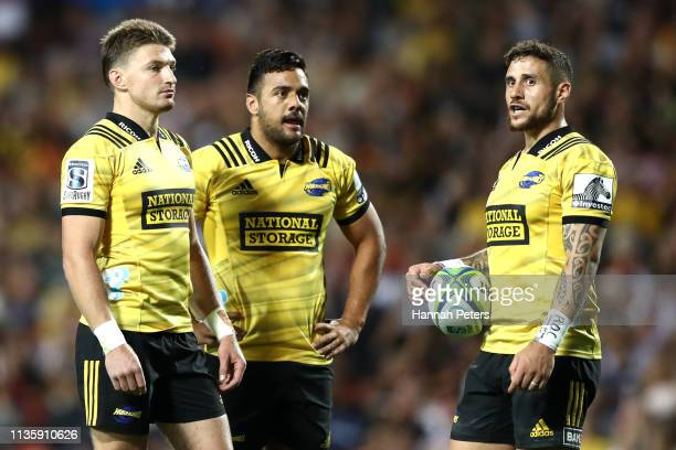 Beauden Barrett Chase Tiatia and TJ Perenara of the Hurricanes look on during the round five Super Rugby match between the Chiefs and the Hurricanes...