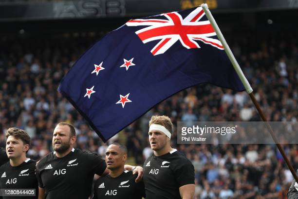 Beauden Barrett, Joe Moody, Aaron Smith and Sam Cane of the All Blacks sing the anthem before the Bledisloe Cup match between the New Zealand All...