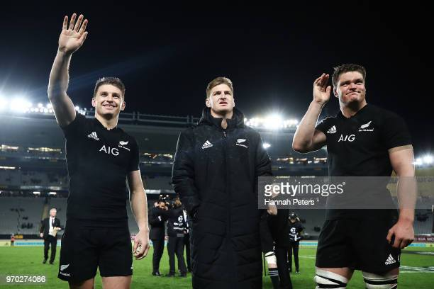 Beauden Barrett Jordie Barrett and Scott Barrett of the All Blacks wave to the crowd after winning the International Test match between the New...