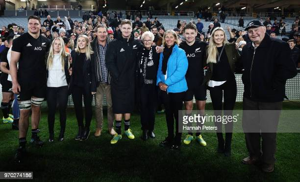 Beauden Barrett Jordie Barrett and Scott Barrett of the All Blacks pose for a photo with thier family after winning the International Test match...