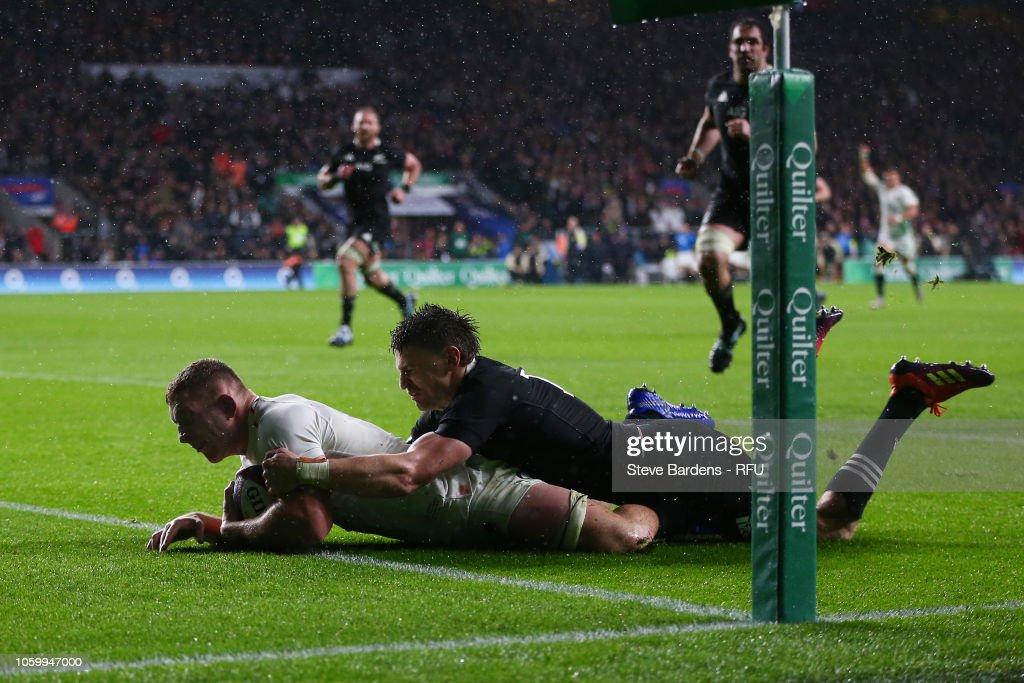 7970cae1a56 Beauden Barrett of New Zealand All Blacks tackles Sam Underhill of ...
