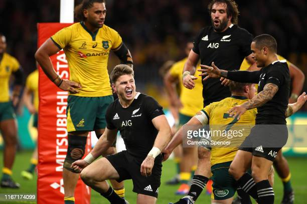 Beauden Barrett of New Zealand celebrates his try with Aaron Smith during the 2019 Rugby Championship Test Match between the Australian Wallabies and...