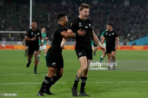 Beauden Barrett of New Zealand celebrates scoring his side's third try with teammate Richie Mo'Unga during the Rugby World Cup 2019 Quarter Final...