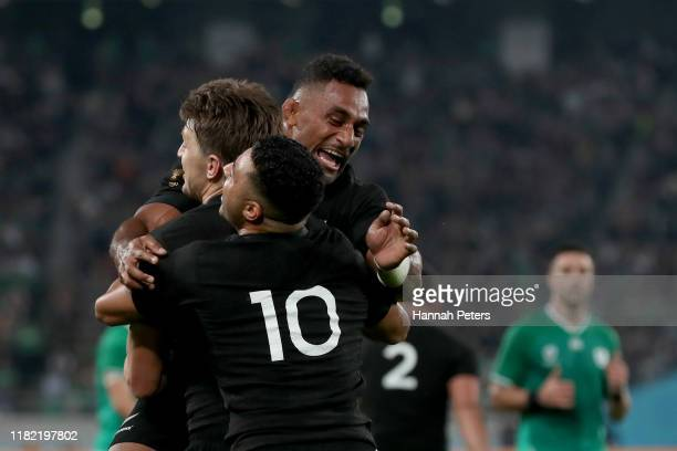 Beauden Barrett of New Zealand celebrates scoring his side's third try with teammates Richie Mo'Unga and Sevu Reece during the Rugby World Cup 2019...