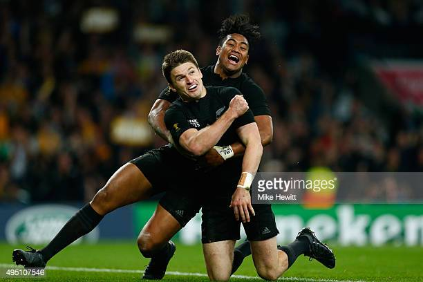 Beauden Barrett of New Zealand celebrates scoring his team's third try with Julian Savea of New Zealand during the 2015 Rugby World Cup Final match...