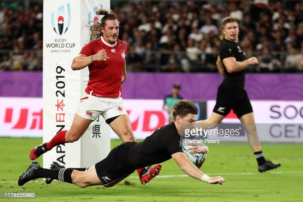 Beauden Barrett of New Zealand dives to score his side's fourth try during the Rugby World Cup 2019 Group B game between New Zealand and Canada at...