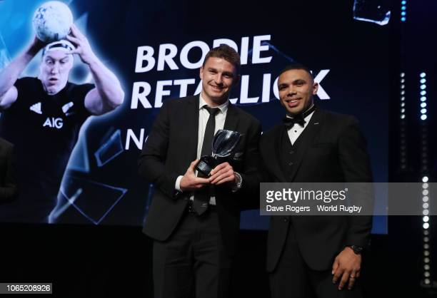 Beauden Barrett of New Zealand on behalf of Brodie Retallick of New Zealand receives the International Rugby Players Try of the Year from Bryan...