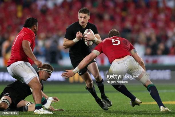 Beauden Barrett of New Zealand runs at the defence of Alun Wyn Jones and Mako Vunipola of the Lions during the International Test match between the...