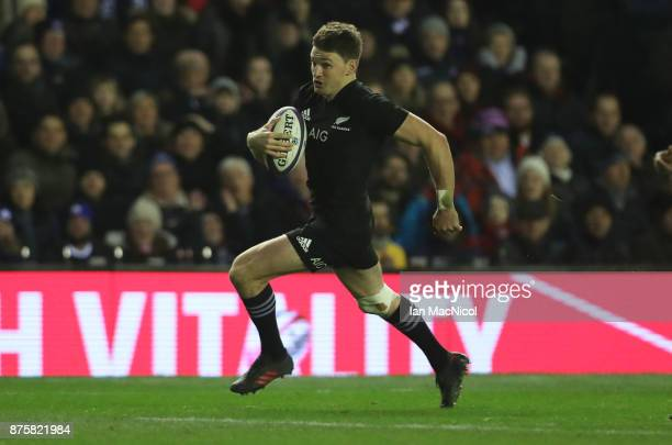 Beauden Barrett of New Zealand runs through to score his teams third try during the International test match between Scotland and New Zealand at...