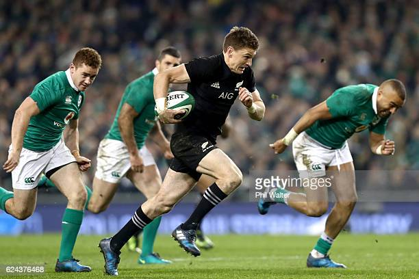 Beauden Barrett of the All Blacks breaks away during the international rugby match between Ireland and the New Zealand All Blacks at Aviva Stadium on...