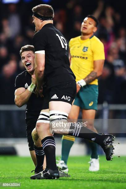 Beauden Barrett of the All Blacks celebrates after scoring the winning try with Scott Barrett during The Rugby Championship Bledisloe Cup match...