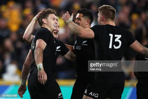 Beauden Barrett of the All Blacks celebrates with team mates after scoring a try during The Rugby Championship Bledisloe Cup match between the...