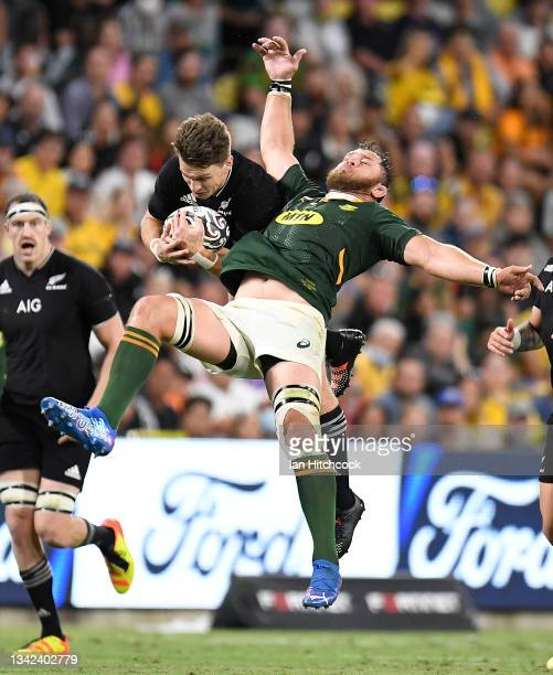 Beauden Barrett of the All Blacks contests the ball with Duane Vermeulen of the Springboks during the Rugby Championship match between the New...