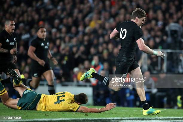 Beauden Barrett of the All Blacks gets through Jack Maddocks of the Wallabies to score a try during The Rugby Championship game between the New...
