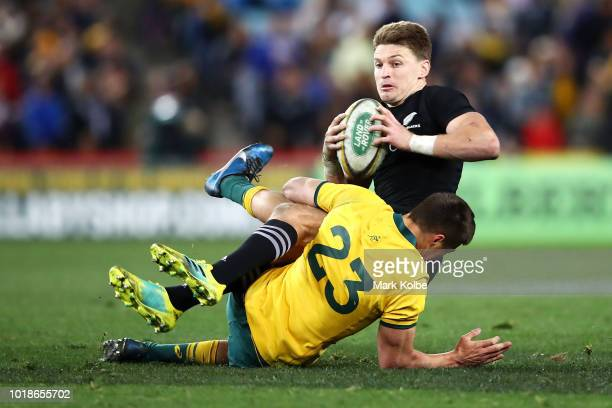 Beauden Barrett of the All Blacks is tackled by Jack Maddocks of the Wallabies during The Rugby Championship Bledisloe Cup match between the...