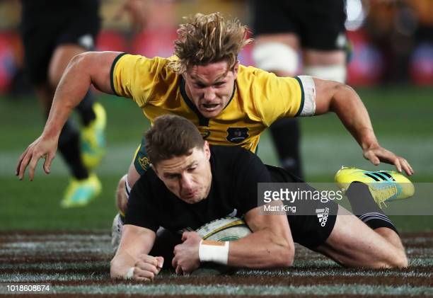 Beauden Barrett of the All Blacks is tackled by Michael Hooper of the Wallabies during The Rugby Championship Bledisloe Cup match between the...
