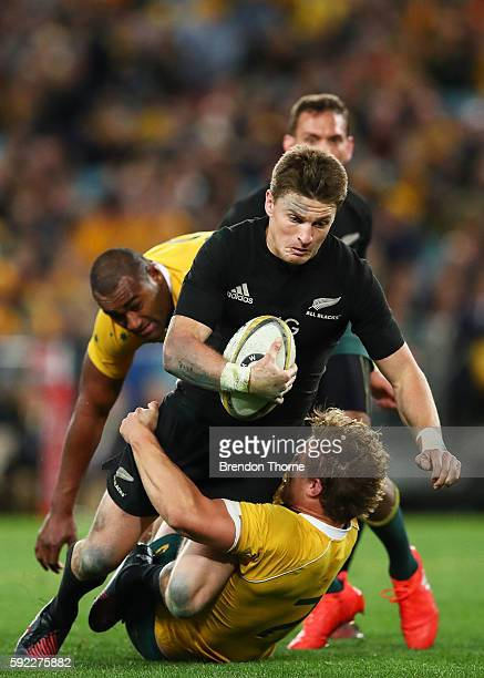 Beauden Barrett of the All Blacks is tackled by Michael Hooper of the Wallabies during the Bledisloe Cup Rugby Championship match between the...