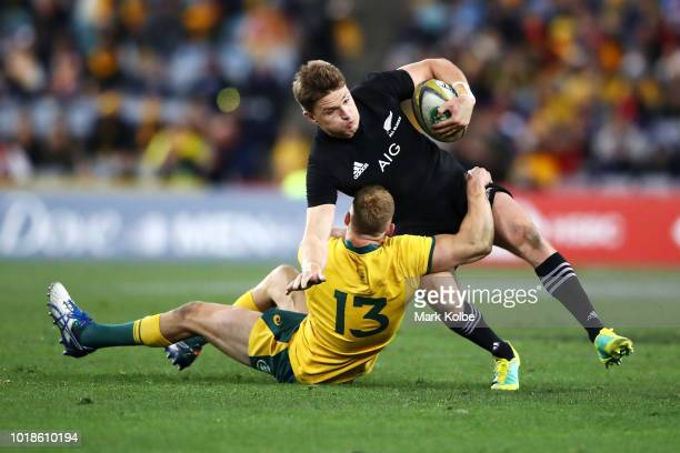 Beauden Barrett of the All Blacks is tackled Reece Hodge of the Wallabies during The Rugby Championship Bledisloe Cup match between the Australian...