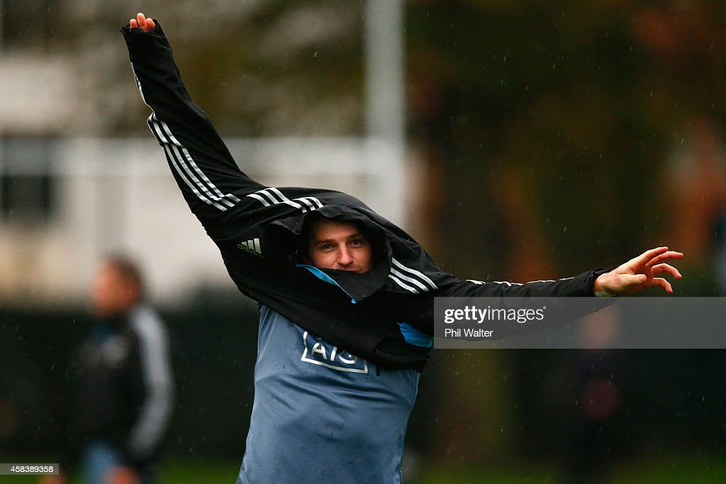 Beauden Barrett of the All Blacks puts on a jacket during a New Zealand All Blacks training session at Latymers on November 4, 2014 in London, England.