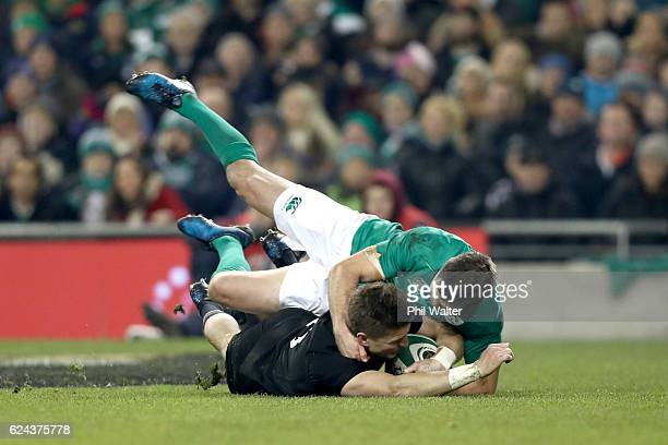 Beauden Barrett of the All Blacks scores a try in the tackle of Johnny Sexton of Ireland during the international rugby match between Ireland and the...