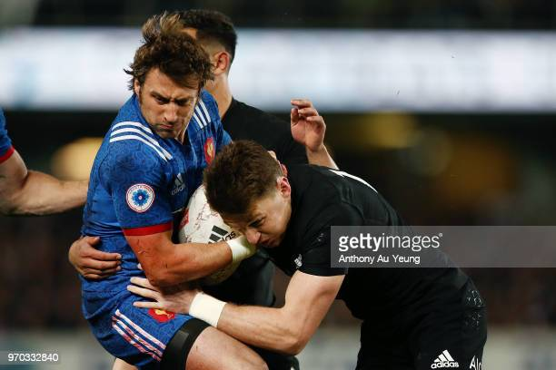 Beauden Barrett of the All Blacks tackles Maxime Medard of France during the International Test match between the New Zealand All Blacks and France...