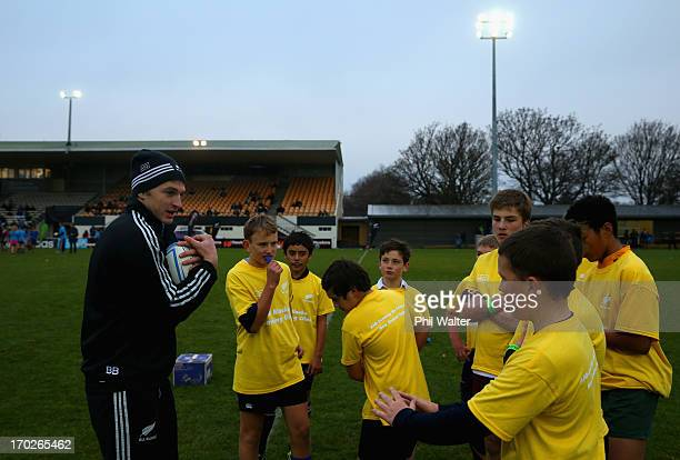 Beauden Barrett of the All Blacks tutiors junior rugby players during a New Zealand All Blacks community activity session at Rugby Park on June 10,...