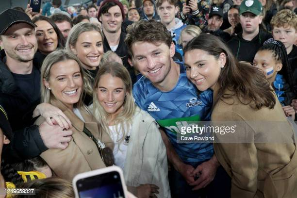 Beauden Barrett of the Blues and his wife Hannah with friends pose for photographs after the round 1 Super Rugby Aotearoa match between the Blues and...