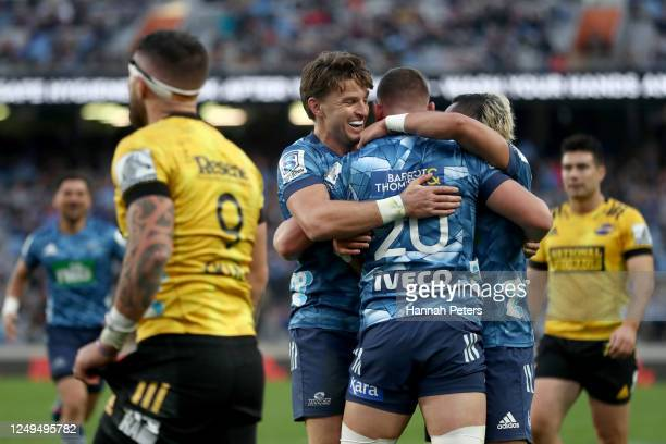 Beauden Barrett of the Blues celebrates after Dalton Papalii of the Blues scored a try during the round 1 Super Rugby Aotearoa match between the...