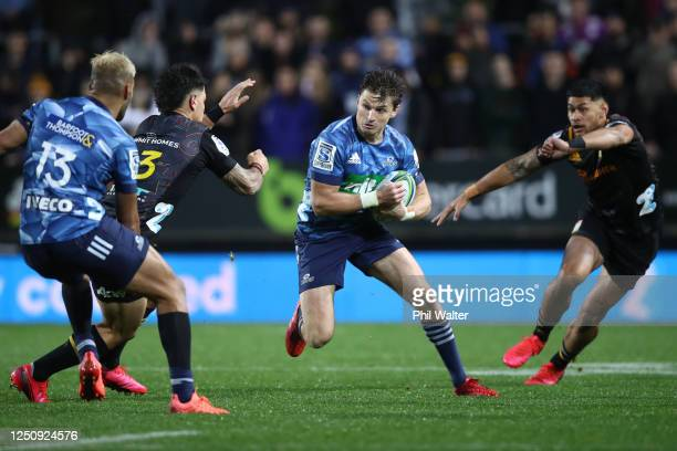 Beauden Barrett of the Blues charges forward during the round 2 Super Rugby Aotearoa match between the Chiefs and the Blues at FMG Stadium Waikato on...