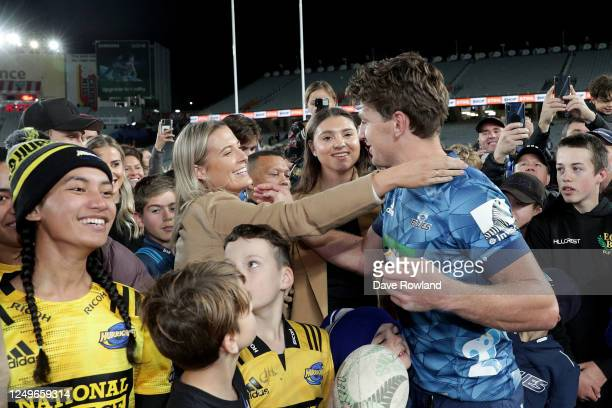 Beauden Barrett of the Blues is greeted by his wife Hannah after the round 1 Super Rugby Aotearoa match between the Blues and the Hurricanes at Eden...