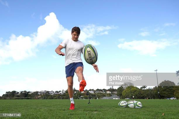 Beauden Barrett of the Blues kicks the ball during a solo training session in isolation at the Shore Road fields on March 26 2020 in Auckland New...