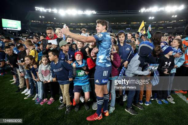 Beauden Barrett of the Blues signs autographs after the round 1 Super Rugby Aotearoa match between the Blues and the Hurricanes at Eden Park on June...