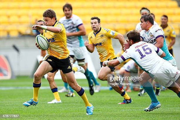 Beauden Barrett of the Hurricanes beats the tackle of Willie le Roux of the Cheetahs on his way to scoring a try during the round five Super Rugby...