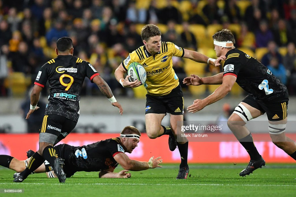 Beauden Barrett of the Hurricanes evades tackles during the round nine Super Rugby match between the Hurricanes and the Chiefs at Westpac Stadium on April 13, 2018 in Wellington, New Zealand.