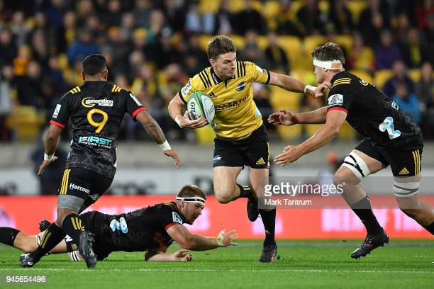 Beauden Barrett of the Hurricanes evades tackles during the round nine Super Rugby match between the Hurricanes and the Chiefs at Westpac Stadium on...