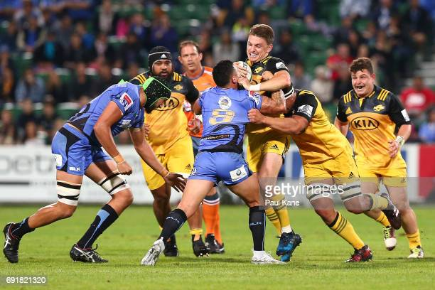 Beauden Barrett of the Hurricanes gets tackled by Michael Ruru of the Force during the round 15 Super Rugby match between the Force and the...
