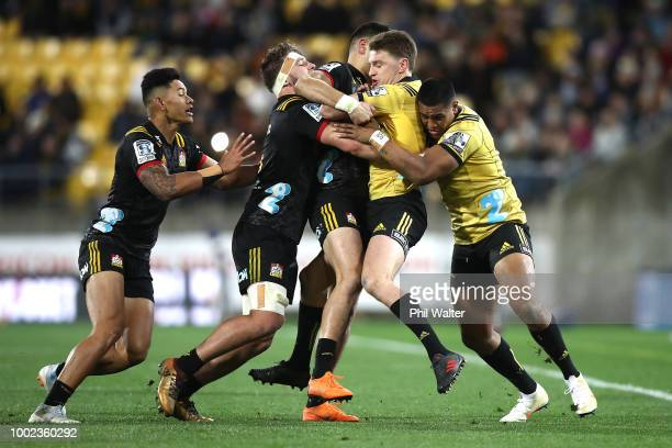 Beauden Barrett of the Hurricanes is tackled during the Super Rugby Qualifying Final match between the Hurricanes and the Chiefs at Westpac Stadium...
