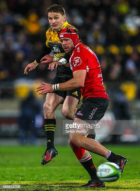 Beauden Barrett of the Hurricanes kicks under pressure from Warren Whiteley of the Lions during the 2016 Super Rugby Final match between the...