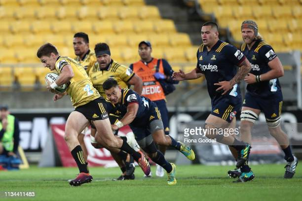 Beauden Barrett of the Hurricanes makes a break during the round 4 Super Rugby match between the Wellington Hurricanes and Otago Highlanders at...