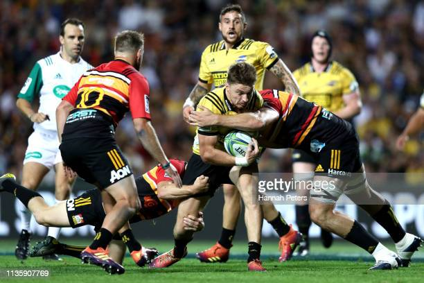 Beauden Barrett of the Hurricanes makes a break during the round five Super Rugby match between the Chiefs and the Hurricanes at FMG Stadium Waikato...
